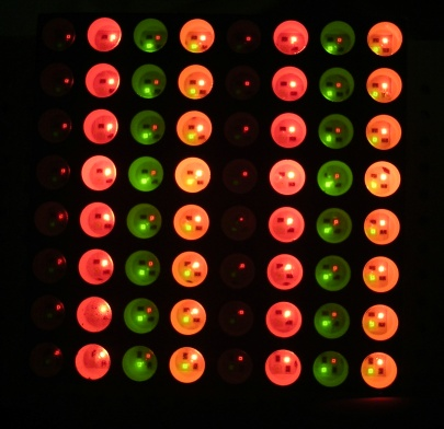 An 8x8 grid of off, red, green, and orange LEDs